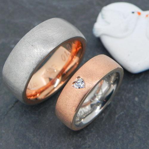 Eheringe aus Palladium und Rotgold rouge royal mit einem Diamant im Herzschliff. Die Trauringe wurden von meinen Kunden im Workshop selber geschmiedet.