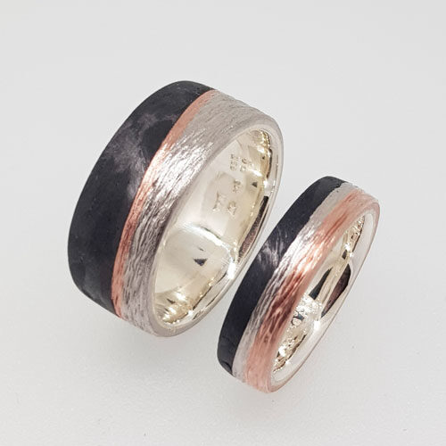 Eheringe aus Silber mit Rotgold und Carbon